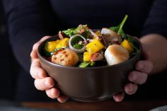 Spring salad topped with scallops