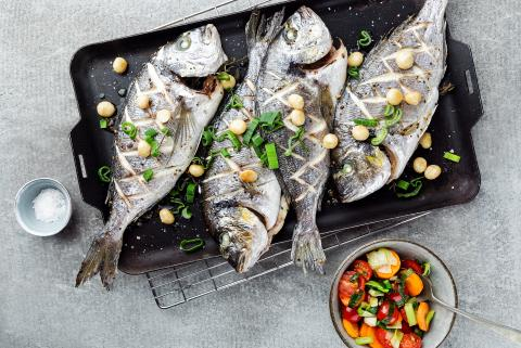 Roasted sea bream with spring vegetables