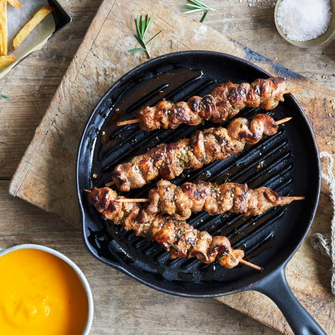 Kebabs with yellow ketchup