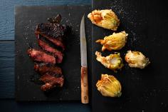 Tagliata with fried courgette flowers