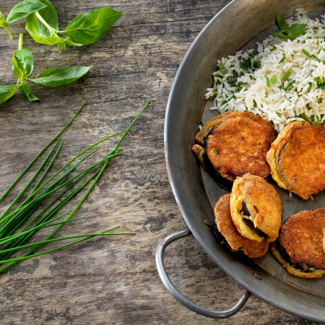 Aubergine piccata with herby rice