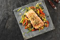 Salmon fillet on a bed of vegetables
