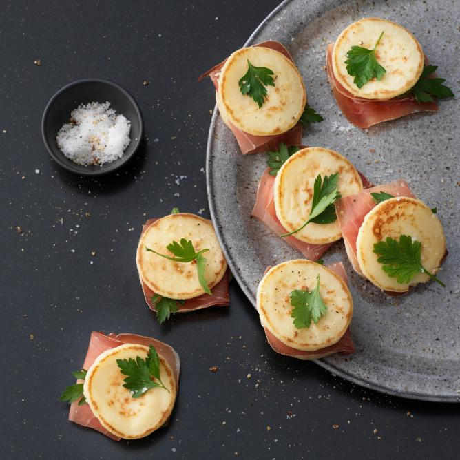 Blinis with cured ham