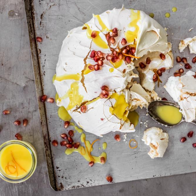 Pavlova with orange sauce and pomegranate