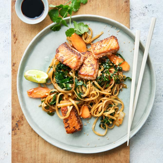 Sesame salmon on a bed of vegetable noodles