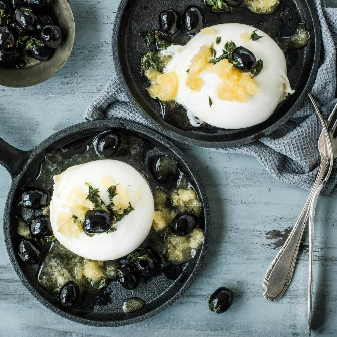 Apricot granita on burrata with black olives