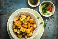 Patatas bravas con mojo verde (Spicy Spanish potatoes with a green sauce)