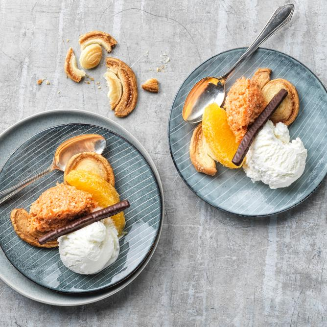 Sweet puff pastry sandwiches with carrot salad and coconut ice cream
