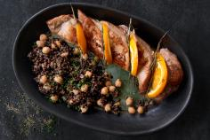 Pork fillet with beluga lentil salad