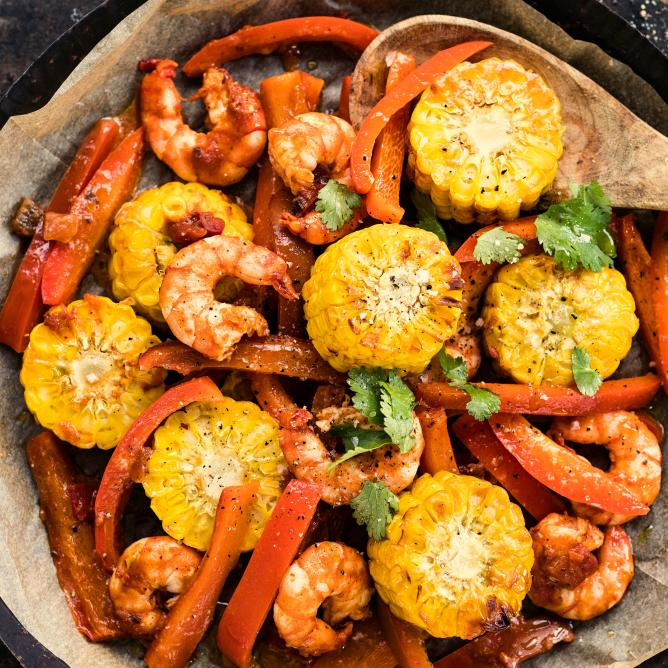 Oven-baked prawns and vegetables