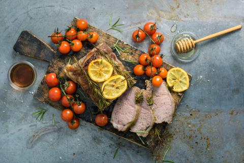 Roast veal with sweet wine and cherry tomatoes