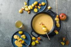 Apple fondue with potato skewers