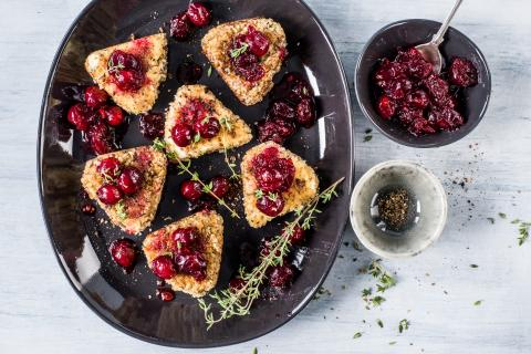 Breaded cheese with cranberry sauce
