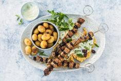 Lamb and olive skewers with tzatziki hummus