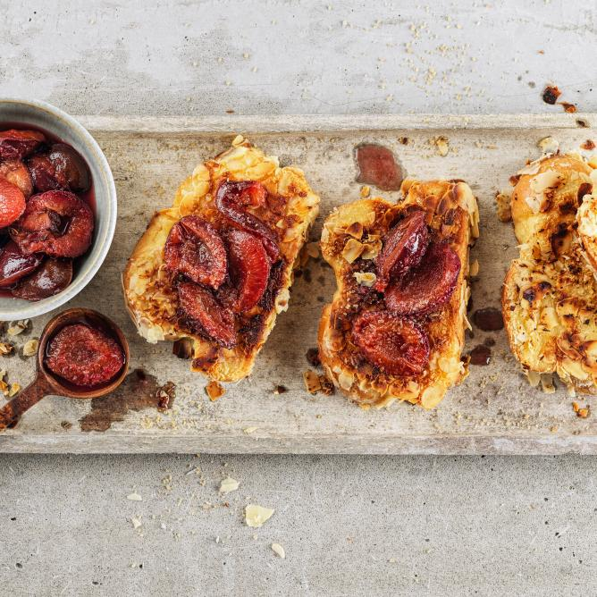 Coconut and almond French toast with plums
