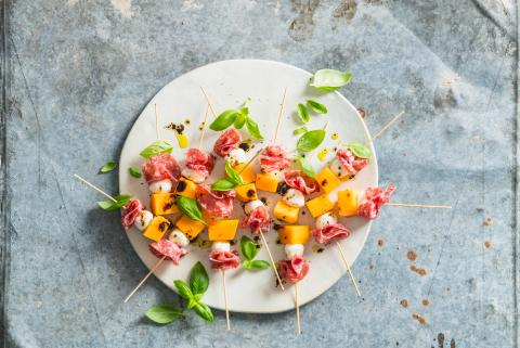 Melon, mozzarella and salami skewers