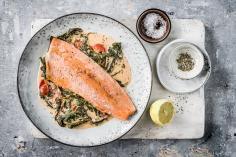 Salmon trout with tomatoes and creamed spinach
