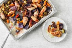 Oven-baked sausages and vegetables