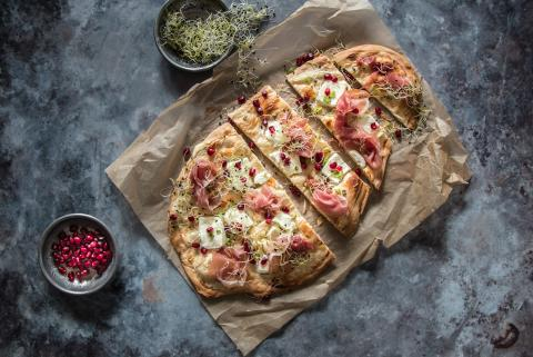 Tarte flambée with soft goat's cheese and cured ham