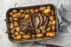 Roast shoulder of lamb with lemon potatoes