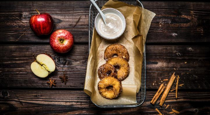 Beer-battered fried apples with cinnamon sauce