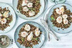 Fish rolls on a bed of balsamic lentils