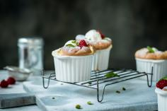 Raspberry and pistachio soufflé with yoghurt ice cream