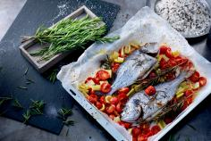 Seabream on a bed of cherry tomatoes
