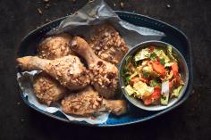 Chicken with a coconut crust and papaya salad