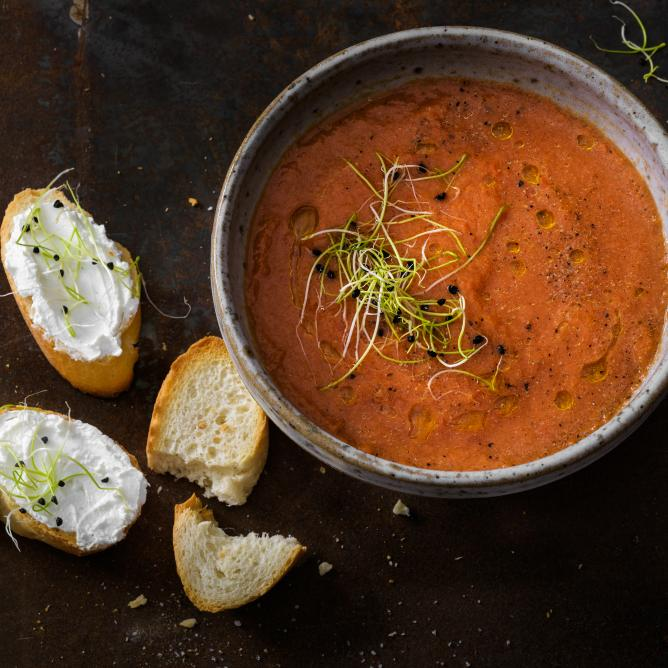 Chilled summer soup with goats' cheese baguette
