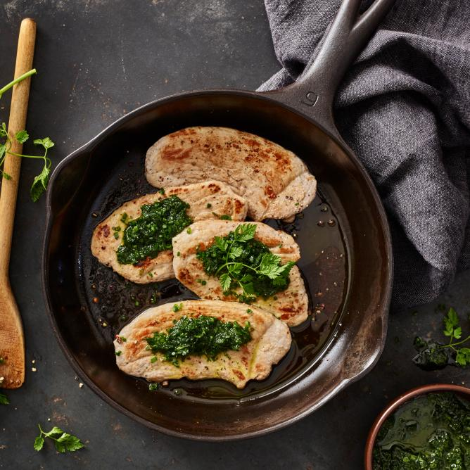 Pork escalope with herb sauce